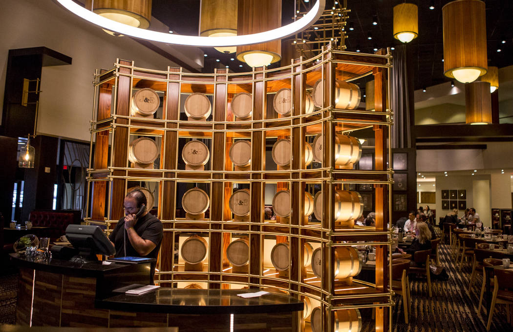 Bourbon barrels are on display at as decorations at the new restaurant Jake & Eli, which replaced the casino floor at the Westin Las Vegas, on Wednesday, Feb. 14, 2018. (Patrick Connolly/Las V ...