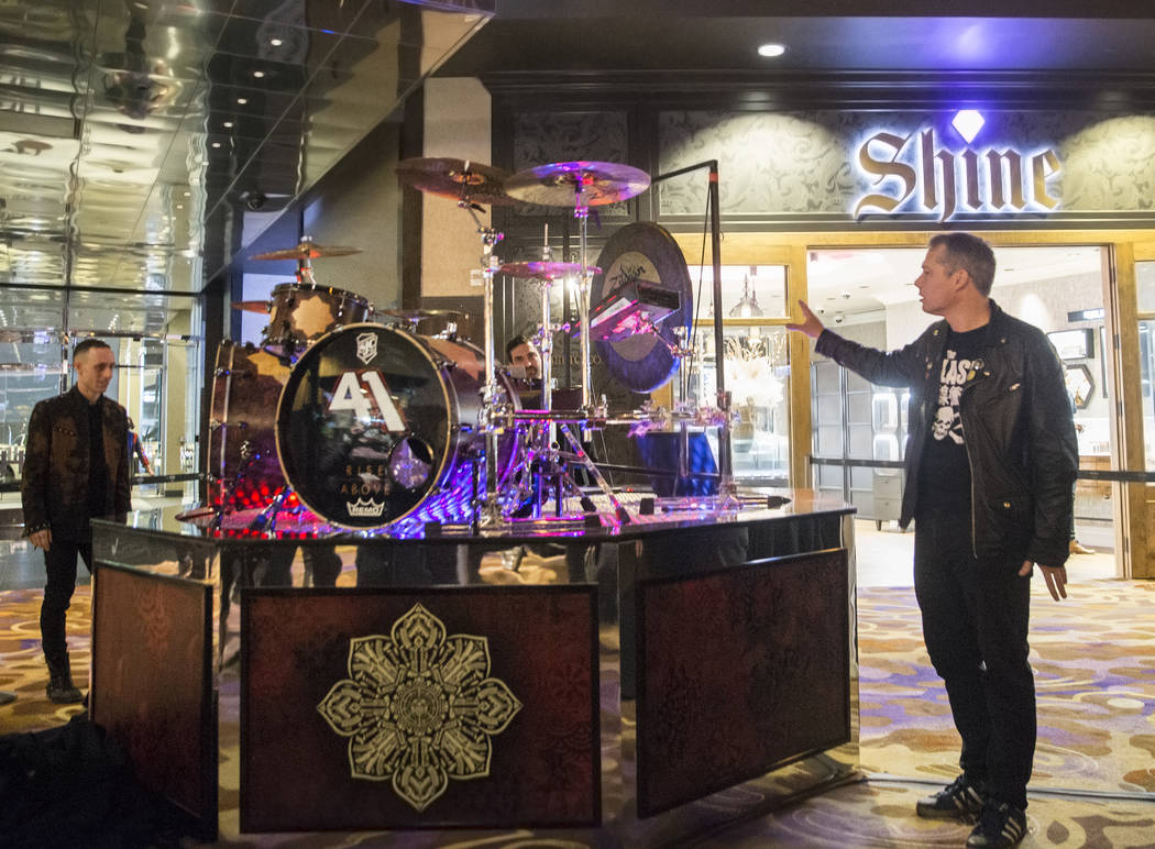Artist Shepard Fairey, right, and Sum 41 drummer Frank Zummo point out features of a custom a drumkit/art project called Rise Above on Friday, February 16, 2018, at The Hard Rock hotel-casino, in  ...