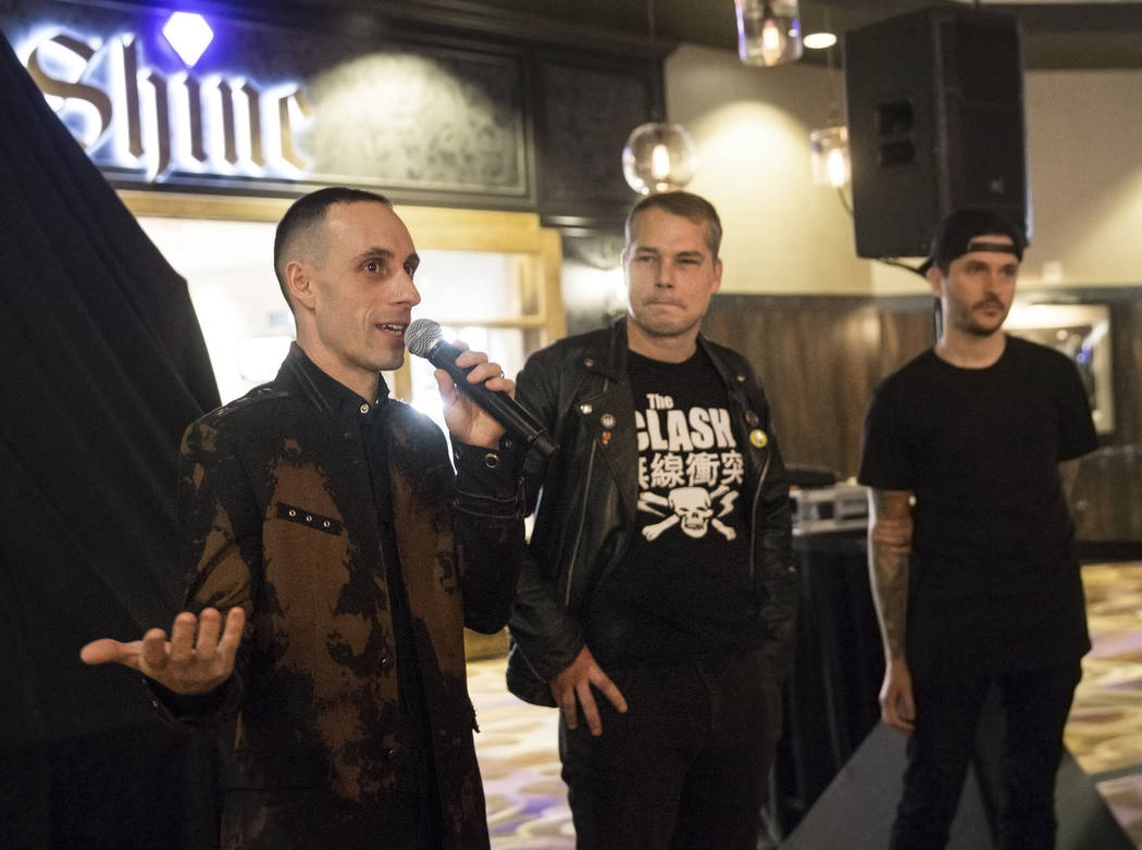 Sum 41 drummer Frank Zummo, left, artist Shepard Fairey and SJC co-founder Mike Ciprary address the crowd during the unveiling of custom a drumkit/art project called Rise Above on Friday, February ...