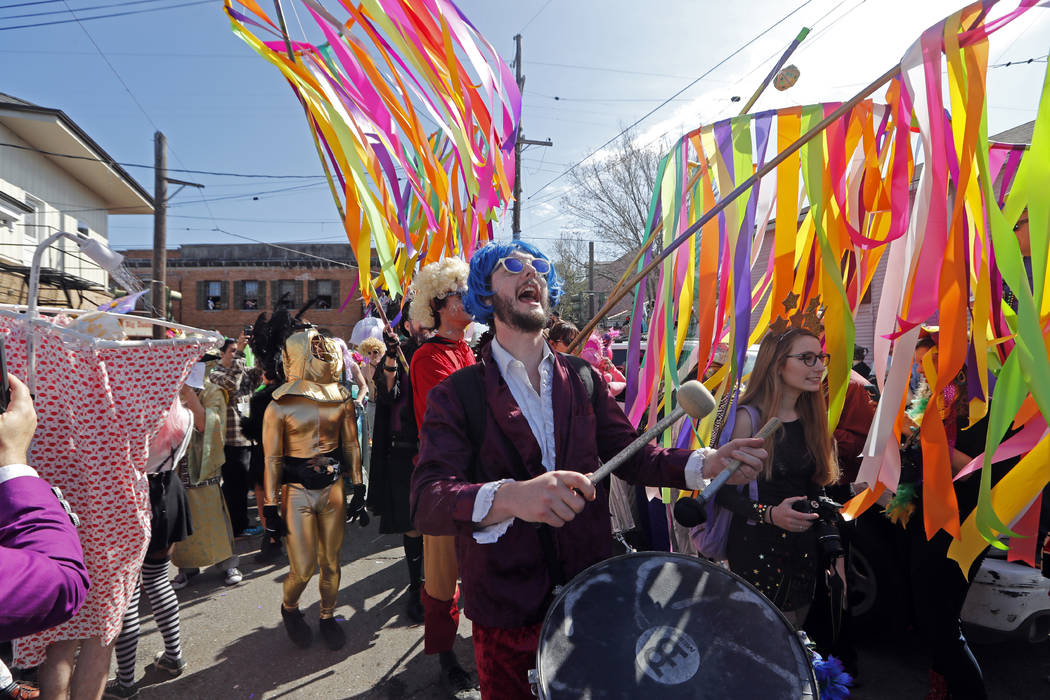 Revelers march during the Society de Sainte Anne parade, on Mardi Gras day in New Orleans, Tuesday, Feb. 13, 2018. (AP Photo/Gerald Herbert)