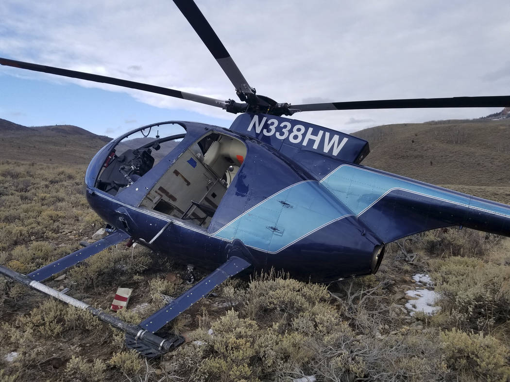 In this photo taken Monday, Feb. 12, 2018, and provided by the Wasatch County Sheriff's Office is a research helicopter that was brought down by a leaping elk in the mountains of eastern Utah. Was ...
