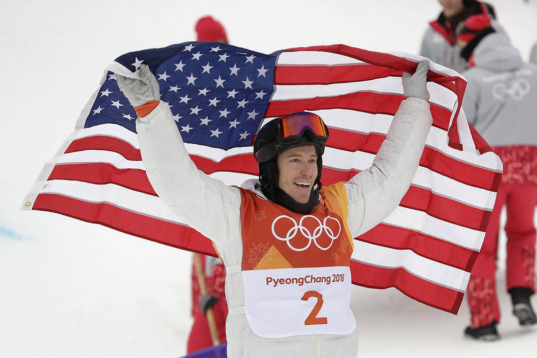 Shaun White, of the United States, celebrates winning gold after his run during the men's halfpipe finals at Phoenix Snow Park at the 2018 Winter Olympics in Pyeongchang, South Korea, Wednesday, F ...
