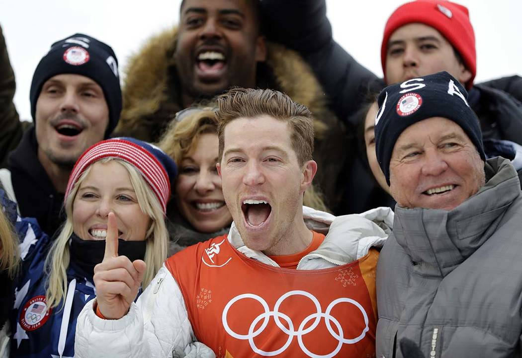 Shaun White, of the United States, celebrates winning gold after the men's halfpipe finals at Phoenix Snow Park at the 2018 Winter Olympics in Pyeongchang, South Korea, Wednesday, Feb. 14, 2018. e ...