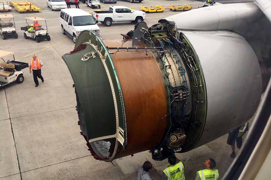 This photo provided by passenger Haley Ebert shows damage to an engine on what the FAA says is a Boeing 777 after parts came off the jetliner during its flight from San Francisco to Honolulu Tuesd ...