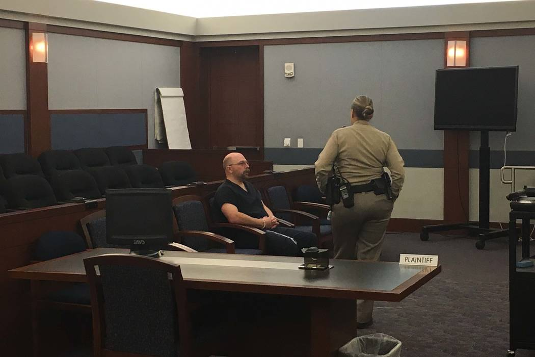 Las Vegas police officer Bret Theil, seated, awaits an arraignment on dozens of sexual assault and kidnapping charges on Wednesday, Feb. 14, 2018. (David Ferrara/Las Vegas Review-Journal)