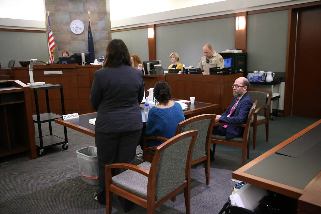 Janet Solander, center, accused of abusing her adopted children, with her attorneys Caitlyn McAmis, left, and Dayvid Figler, during opening statements in her trial at the Regional Justice center i ...