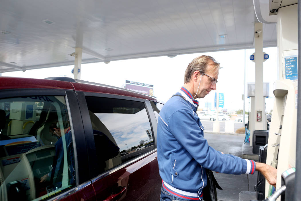Tourist from Holland Rimko Band uses a credit card to pay for gas at a gas station located on East Tropicana Avenue and Paradise Road in Las Vegas, Tuesday, Sept. 26, 2017. (Elizabeth Brumley Las  ...