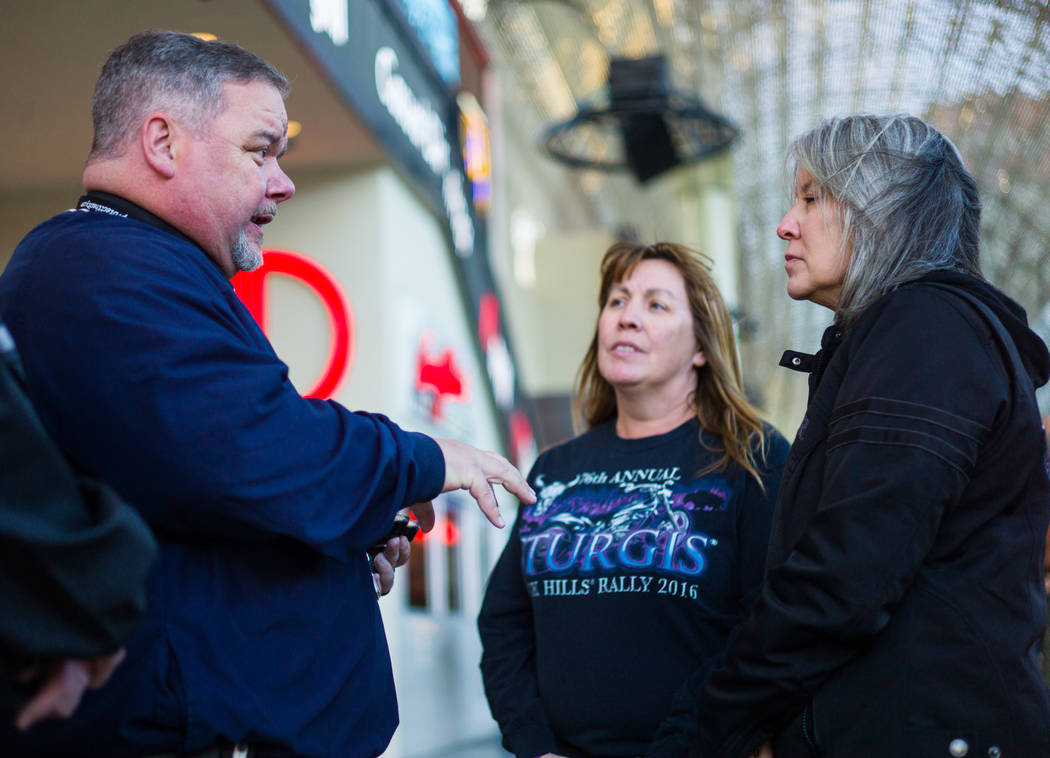 Steve Willis, a senior pastor at First Christian Church, left, talks with Michelle Caldwell, center, and Barbara Foster, both of Ill., before marking their foreheads for Ash Wednesday on Fremont S ...