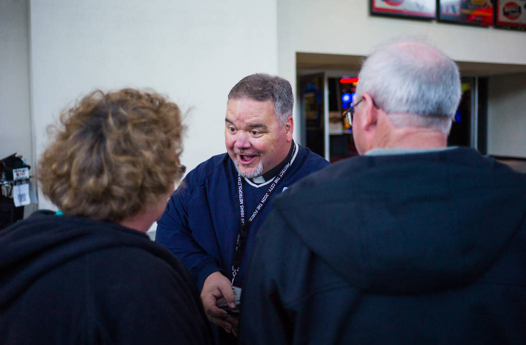 Steve Willis, a senior pastor at First Christian Church, greets tourists along Fremont Street in downtown Las Vegas for Ash Wednesday on Feb. 14, 2018. Ash Wednesday marks the first day of Lent. C ...