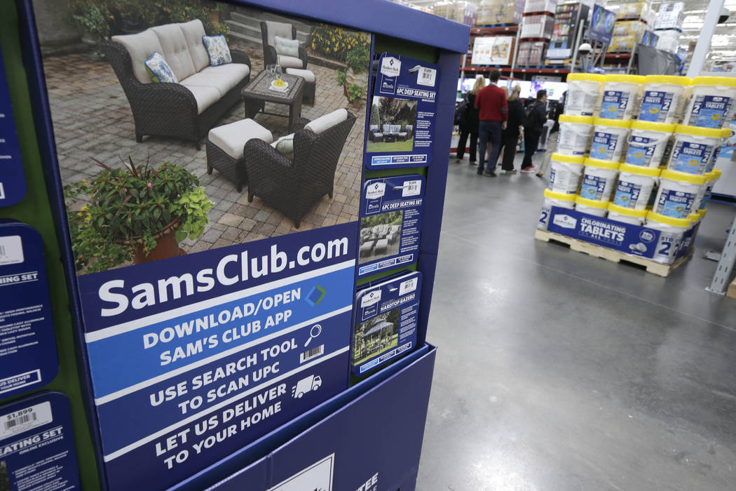 A sign encouraging shoppers to use a Sam's Club phone app is displayed at one of the company's stores in Bentonville, Ark., June 4, 2015. Starting Wednesday, Feb. 14, 2018, the Walmart-owned wareh ...
