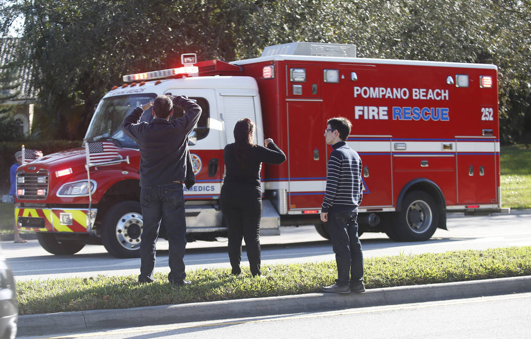 Anxious family members watch a rescue vehicle pass by, Wednesday, Feb. 14, 2018, in Parkland, Fla. A shooting at Marjory Stoneman Douglas High School school sent students rushing into the streets  ...