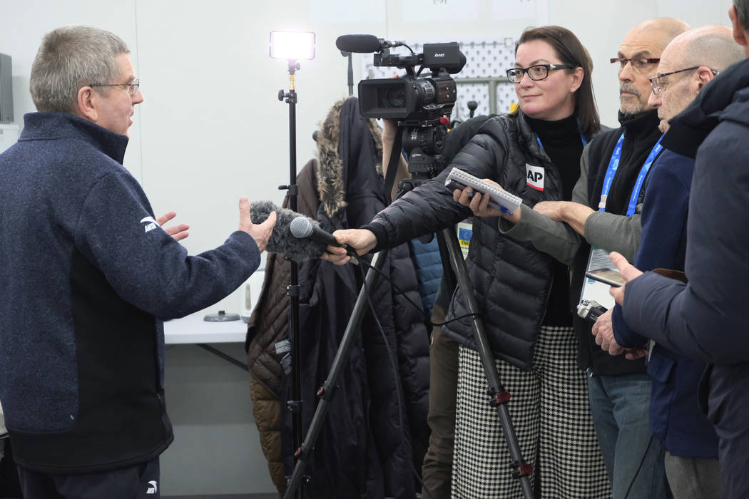Thomas Bach, President of the International Olympic Committee speaks to Associated Press reporters at the 2018 Winter Olympics in Pyeongchang, South Korea, Monday, Feb. 12, 2018. (AP Photo/Alyssa  ...