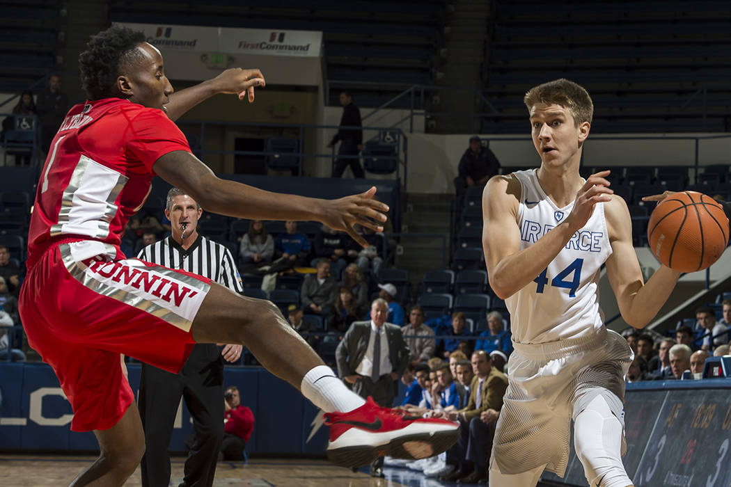 Air Force guard Keaton Van Soelen, right, looks for an open teammate as UNLV's Kris Clyburn defends during an NCAA college basketball game at Air Force Academy, Colo., Wednesday, Jan. 10, 2018. (D ...