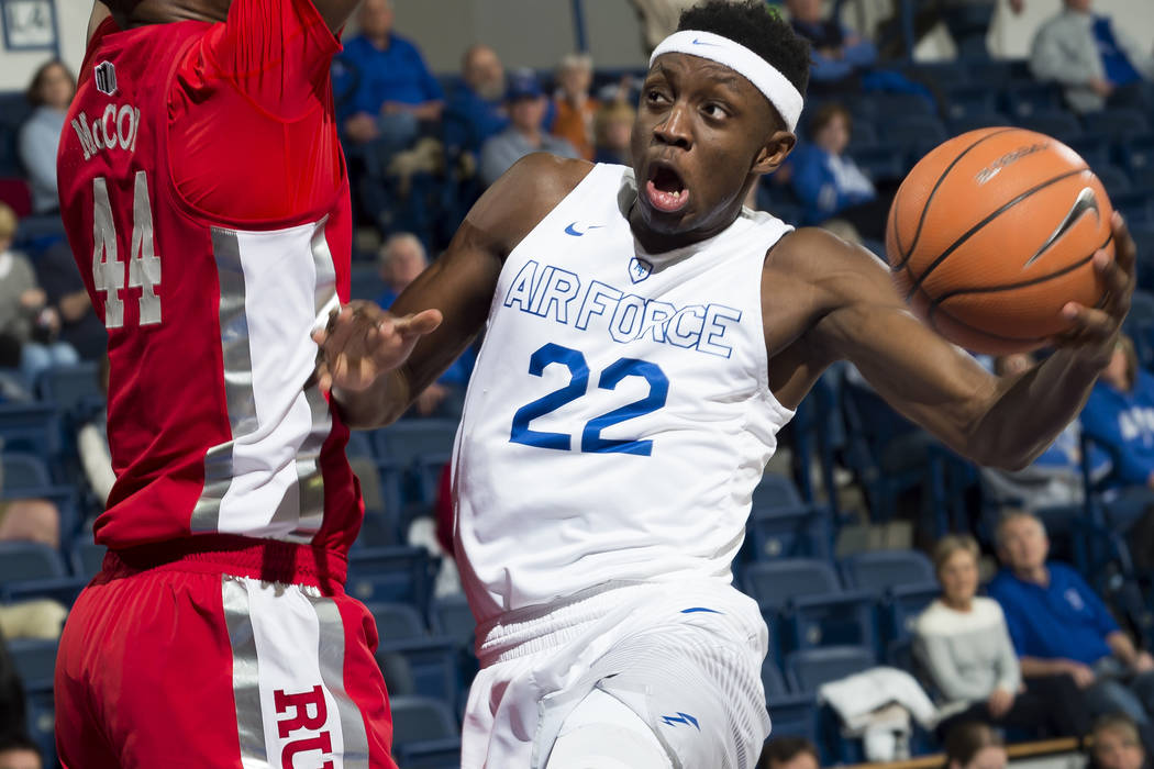 Air Force guard Pervis Louder (22) drives as UNLV's Brandon McCoy defends during an NCAA college basketball game at Air Force Academy, Colo., Wednesday, Jan. 10, 2018. (Dougal Brownlie/The Gazette ...