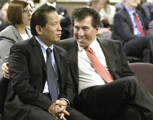 This June 17, 2004 file photo shows Las Vegas casino mogul Steve Winn, right, talking with his business partner Kazuo Okada during a Gaming Commission hearing in Carson City, Nev.  (File, LAS VEGA ...