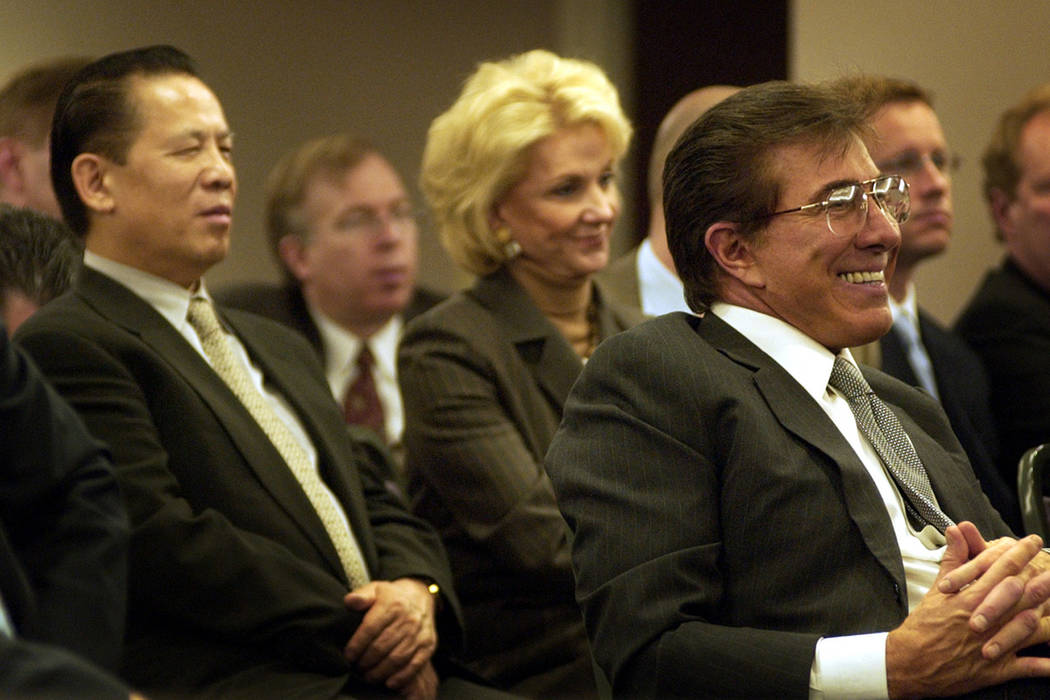 Steve Wynn, right, his wife Elaine Wynn, center and Kazuo Okada, vice chairman of the board, left attend a Nevada Gaming Commission Meeting in Las Vegas Thursday, March 24, 2005.  (AP Photo/Isaac  ...