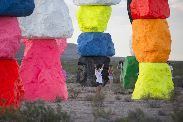People explore the area at Seven Magic Mountains near Jean, Nev. on Monday, May 16, 2016. Chase Stevens/Las Vegas Review-Journal Follow @csstevensphoto