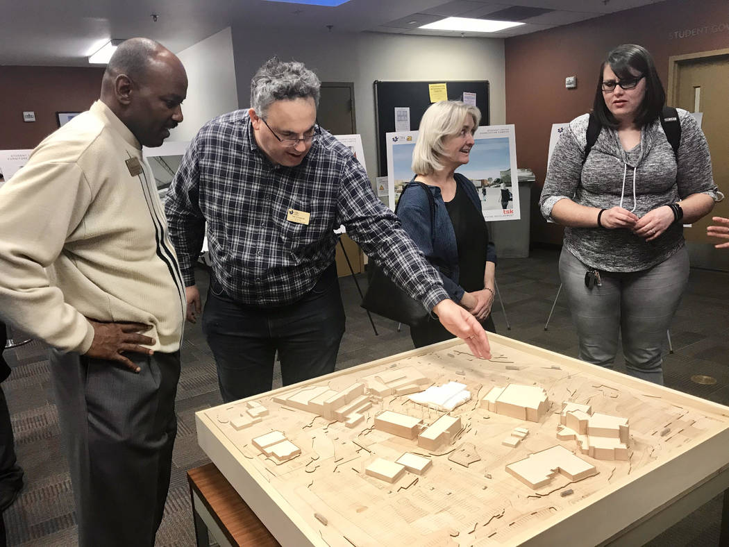 Will Lewis, director of planning and design at the College of Southern Nevada, left, and Ted Chodock, a librarian at CSN, review a model showing the location of a new student union on the Charlest ...