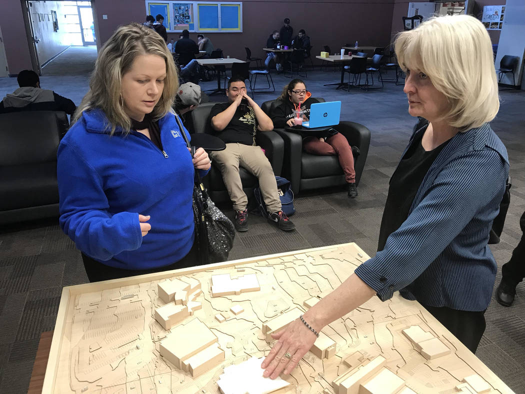 Janelle Benedetti, counselor at the College of Southern Nevada, left, and Sherri Payne, senior associate vice president of facilities management at CSN, review a model showing the location of a ne ...