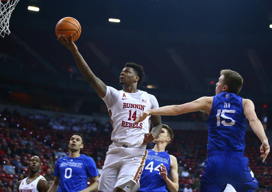 UNLV Rebels forward Tervell Beck (14) goes to the basket past Air Force Falcons guard Jacob Van (15) during a basketball game at the Thomas & Mack Arena in Las Vegas on Wednesday, Feb. 14, 201 ...