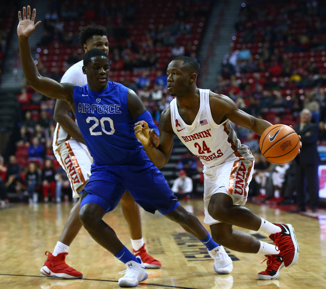 UNLV Rebels guard Jordan Johnson (24) drives against Air Force Falcons guard Trevor Lyons (20) during a basketball game at the Thomas & Mack Arena in Las Vegas on Wednesday, Feb. 14, 2018. Cha ...