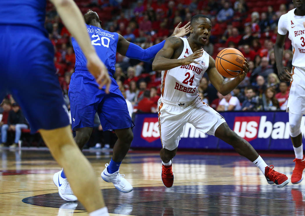 UNLV Rebels guard Jordan Johnson (24) drives to the basket past Air Force Falcons guard Trevor Lyons (20) during a basketball game at the Thomas & Mack Arena in Las Vegas on Wednesday, Feb. 14 ...