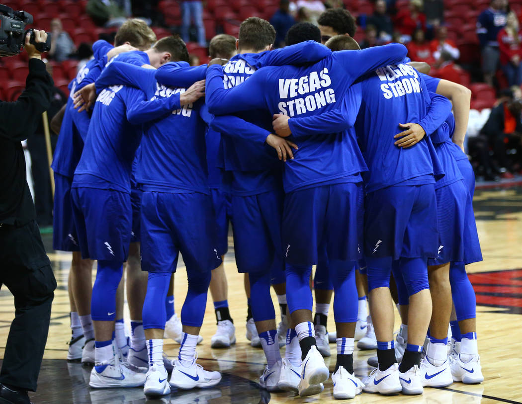 Air Force Falcons players, wearing Vegas Strong shirts, huddle before taking on the UNLV Rebels in a basketball game at the Thomas & Mack Arena in Las Vegas on Wednesday, Feb. 14, 2018. Chase  ...