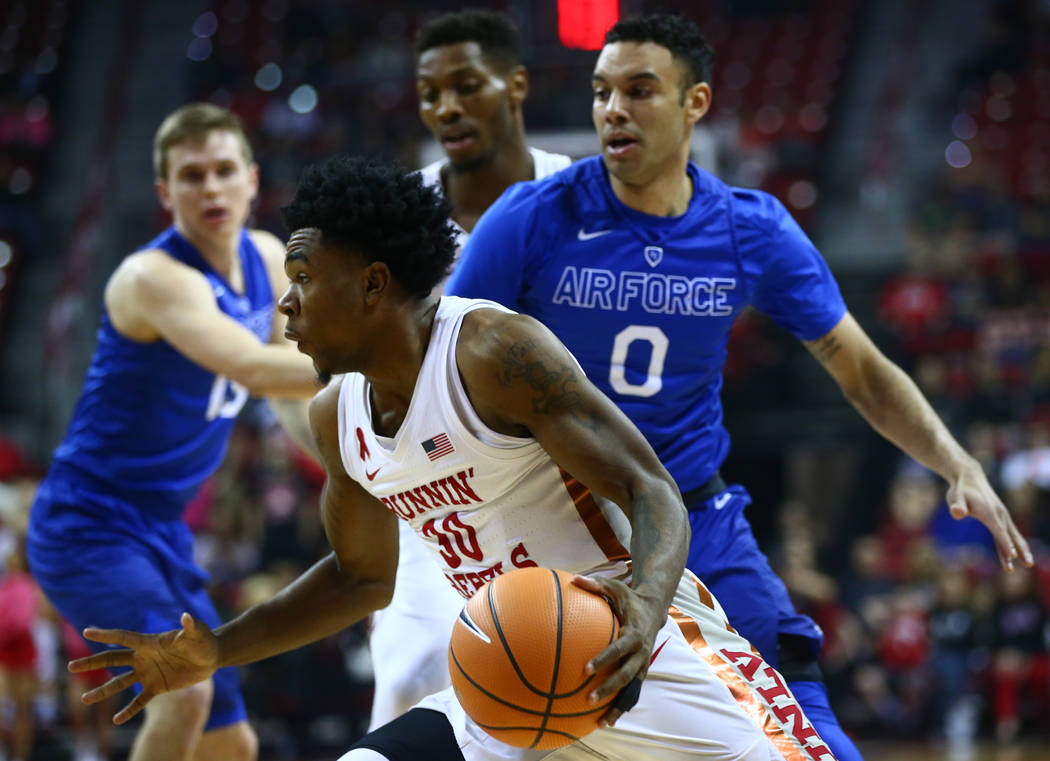 UNLV Rebels guard Jovan Mooring (30) drives to the basket past Air Force Falcons guard Caleb Morris (0) during a basketball game at the Thomas & Mack Arena in Las Vegas on Wednesday, Feb. 14,  ...