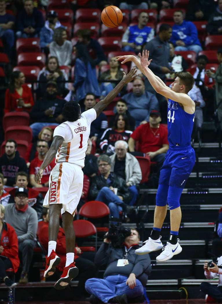 Air Force Falcons guard Keaton Van Soelen (44) shoots over UNLV Rebels guard Kris Clyburn (1) during a basketball game at the Thomas & Mack Arena in Las Vegas on Wednesday, Feb. 14, 2018. Chas ...