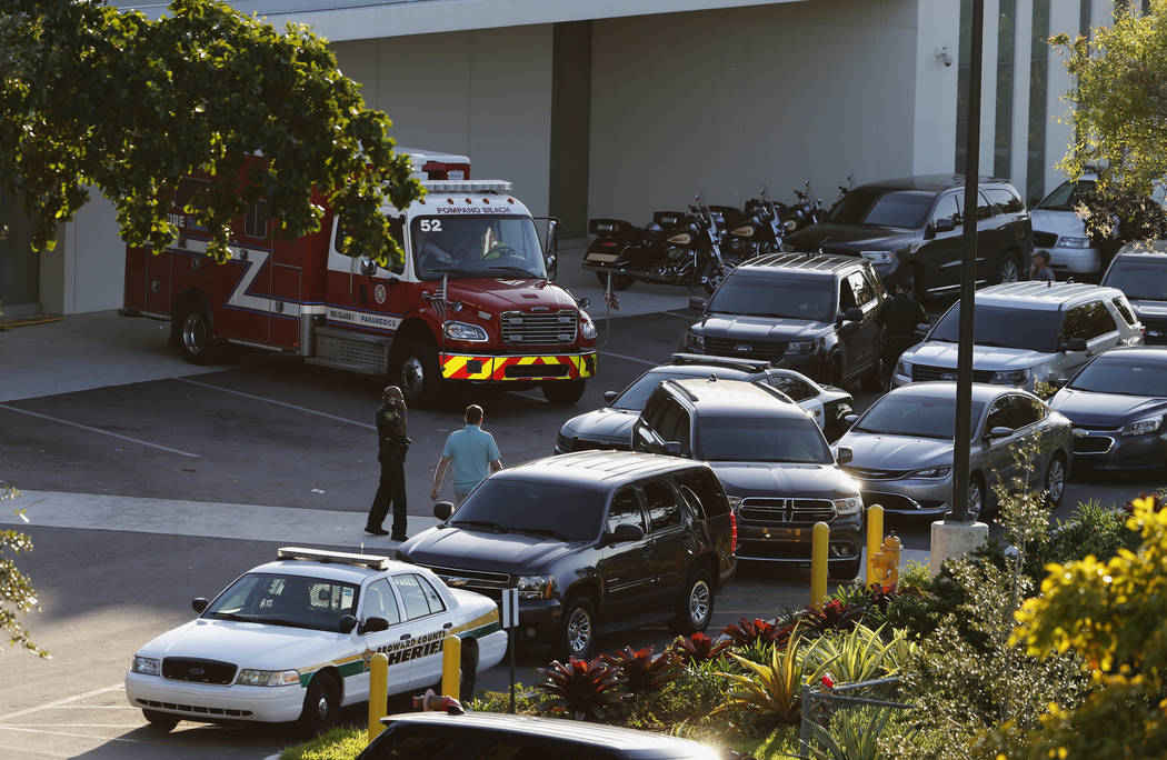 Police and rescue vehicles are shown outside Broward Health North hospital, Wednesday, Feb. 14, 2018, in Deerfield Beach, Fla. A shooter opened fire at a Florida high school Wednesday, killing peo ...