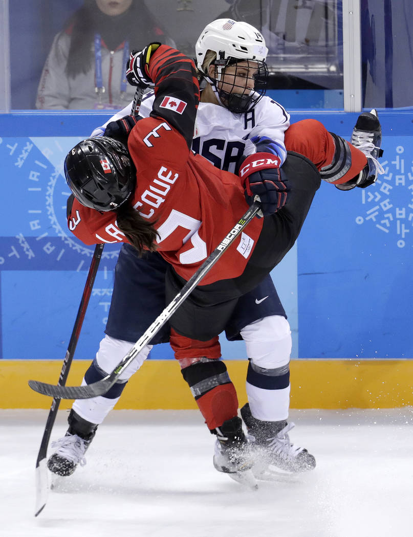 Jocelyne Larocque (3), of Canada, collides with Brianna Decker (14), of the United States, during the third period of a preliminary round during a women's hockey game at the 2018 Winter Olympics i ...