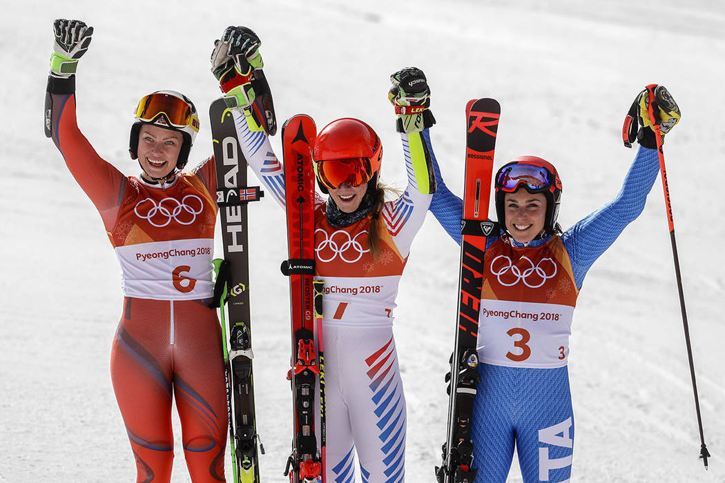 Silver medalist Ragnhild Mowinckel, of Norway, left, gold medalist Mikaela Shiffrin, of the United States, and bronze medalist Federica Brignone, of Italy, celebrate in the finish area after the W ...