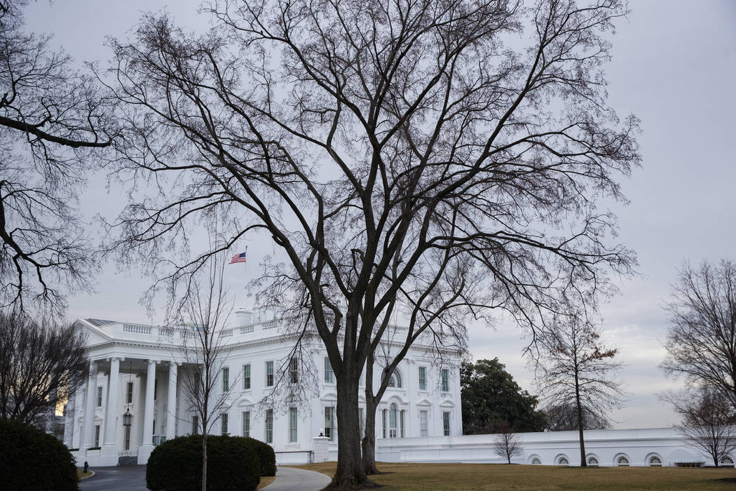 The flag above the White House is lowered to half-staff for the shooting victims of a mass shooting in a South Florida High School, Thursday, Feb. 15, 2018, in Washington. (Evan Vucci/AP)