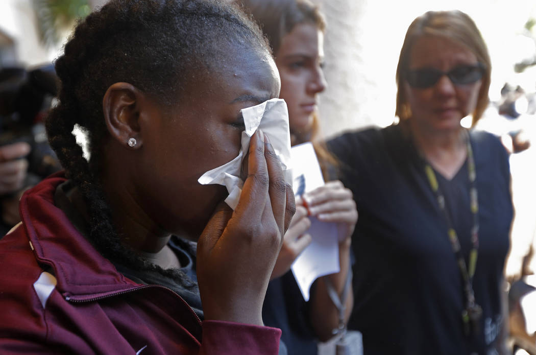 Marla Eveillard, 14, cries before the start of a vigil at the Parkland Baptist Church, for the victims of the Marjory Stoneman Douglas High School shooting in Parkland, Fla., Thursday, Feb. 15, 20 ...