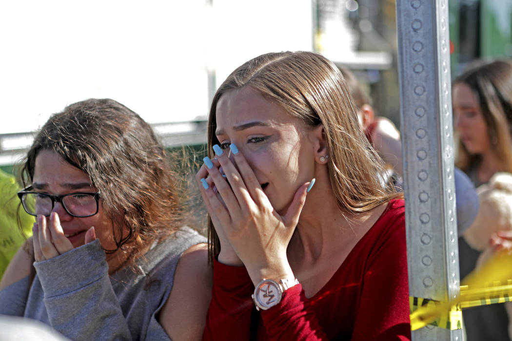 Students released from a lockdown are overcome with emotion following following a shooting at Marjory Stoneman Douglas High School in Parkland, Fla., Wednesday, Feb. 14, 2018. (John McCall/South F ...