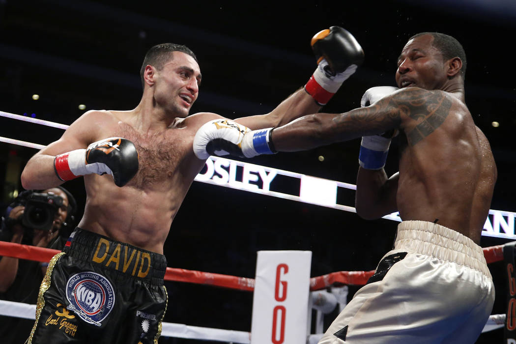 David Avanesyan, left, throws a left at Shane Mosley during the third round of a boxing bout for the WBA interim welterweight title Saturday, May 28, 2016, in Glendale, Ariz. Avanesyan defeated Mo ...