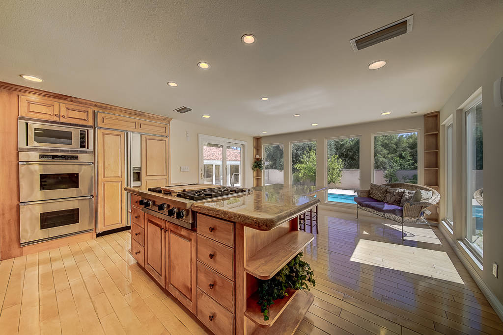 The kitchen has double ovens, custom wood cabinetry and granite countertop. (Nevada Realty Connection)