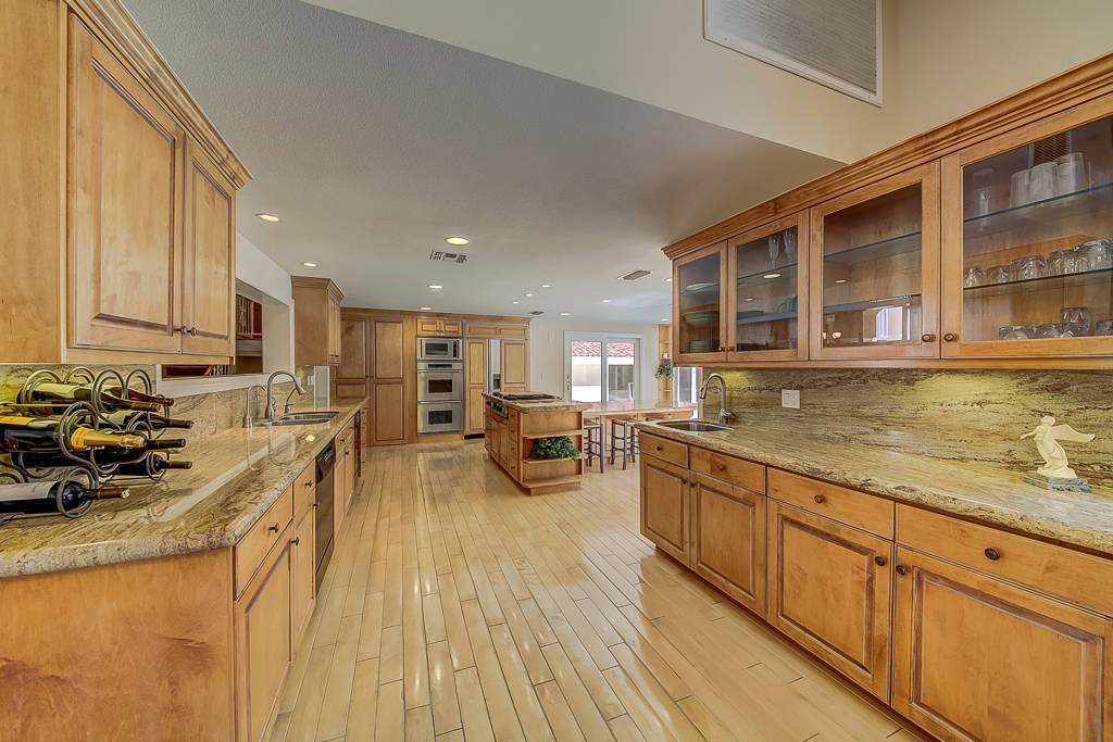 The home has an open kitchen with island. (Nevada Realty Connection)