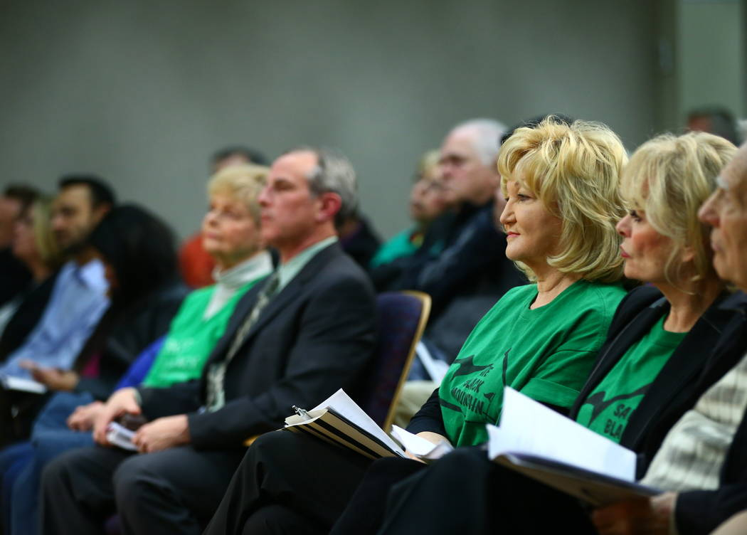 Denell Hahn, center right, a resident of the Black Mountain Golf and Country Club area, listens during a Henderson City Council meeting on Tuesday, Feb. 20, 2018. The course went into bankruptcy l ...