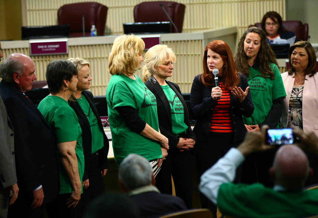Henderson Mayor Debra March, in red, recognizes the founding of the Black Mountain Neighborhood Association during a Henderson City Council meeting on Tuesday, Feb. 20, 2018. The Black Mountain Go ...