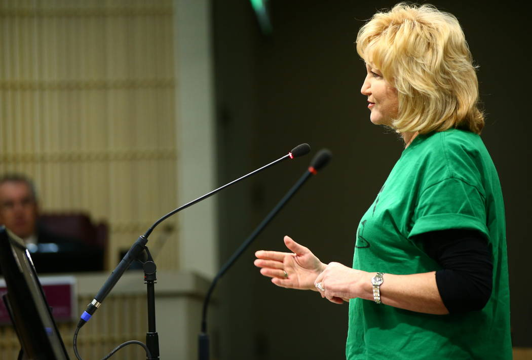 Denell Hahn, a resident of the Black Mountain Golf and Country Club area, speaks during a Henderson City Council meeting on Tuesday, Feb. 20, 2018. The course went into bankruptcy last year, with  ...