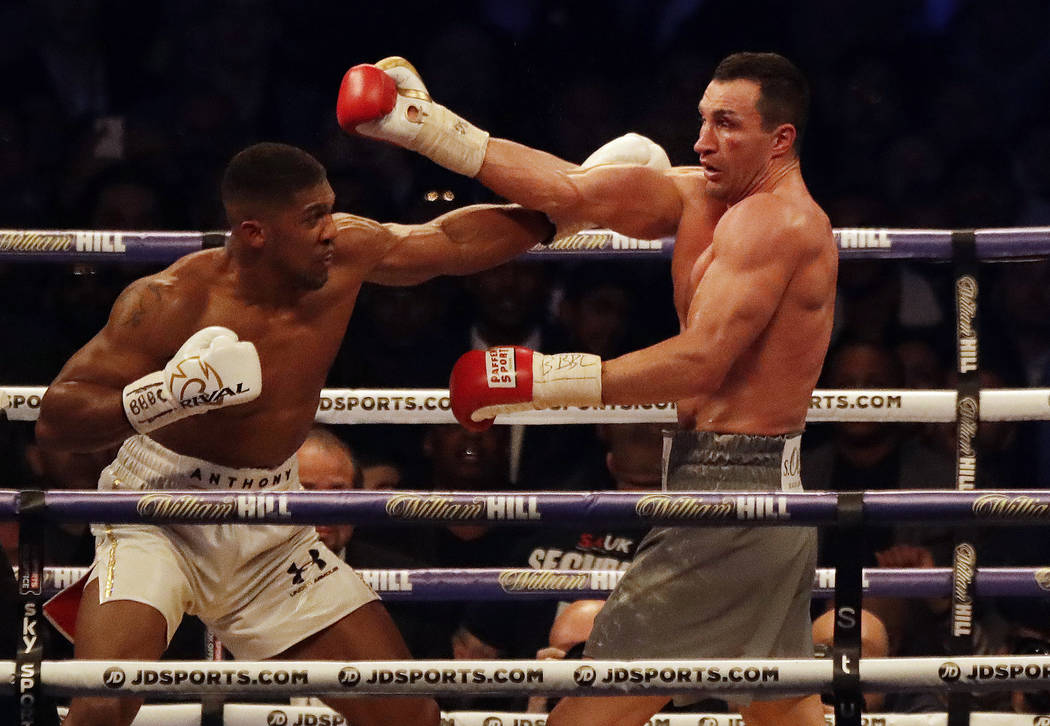 British boxer Anthony Joshua, left, fights Ukrainian boxer Wladimir Klitschko for Joshua's IBF and the vacant WBA Super World and IBO heavyweight titles at Wembley stadium in London, Saturday, Apr ...