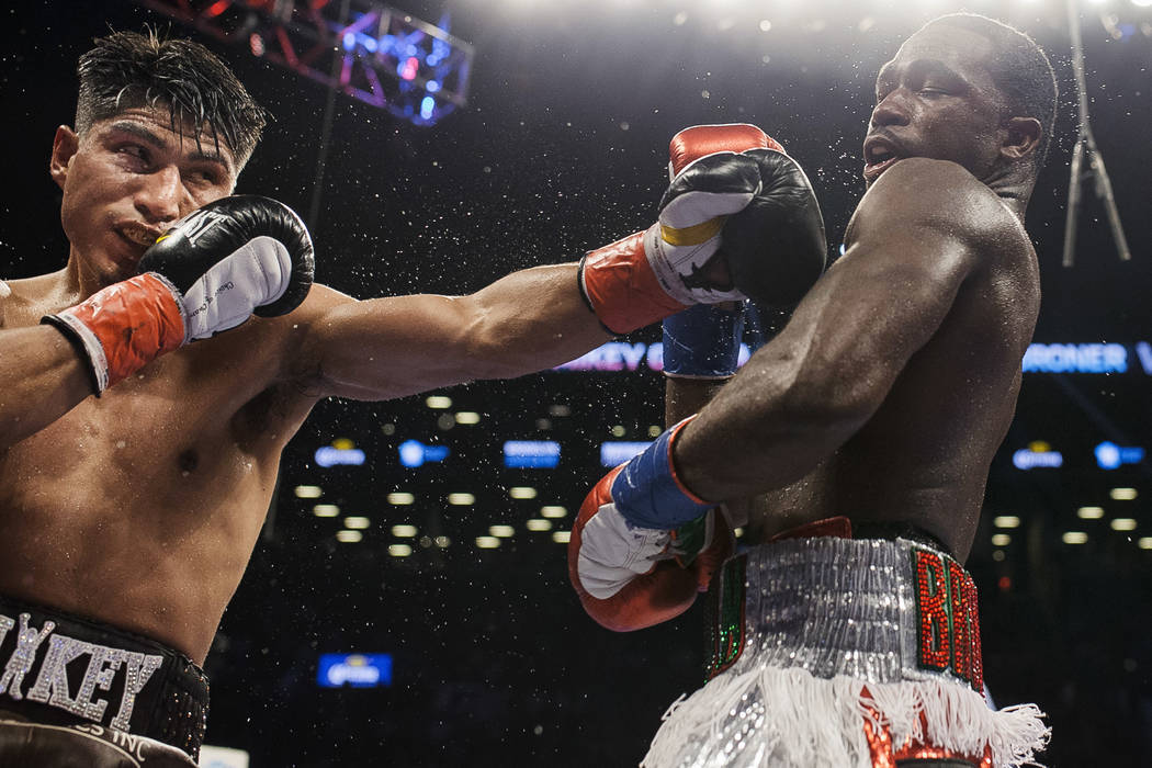 Mikey Garcia, left attempts to hit Adrien Broner during a boxing bout at 140 pounds, Saturday, July 29, 2017, in New York. (AP Photo/Andres Kudacki)