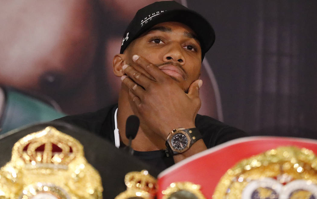 World Heavyweight boxers Anthony Joshua of Britain pauses during a media conference with New Zealand's Joseph Parker in London, Tuesday, Jan. 16, 2018. Their unification title bout with Joshua's I ...