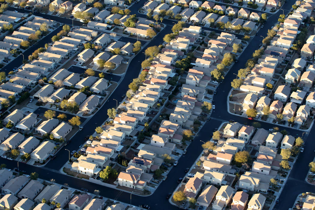 Southwest Las Vegas homes are seen from a hot air balloon piloted by Daniel Liberti of Rainbow Ryders during an early morning flight Wednesday, Jan. 24, 2018. K.M. Cannon Las Vegas Review-Journal  ...