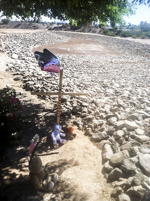 Balloons and stuffed toys are near the lot at Chaparral and Country Club drives in Bullhead City, Arizona, where the body of 8-year-old Isabella Grogan-Cannella was found in September 2014. (Annal ...