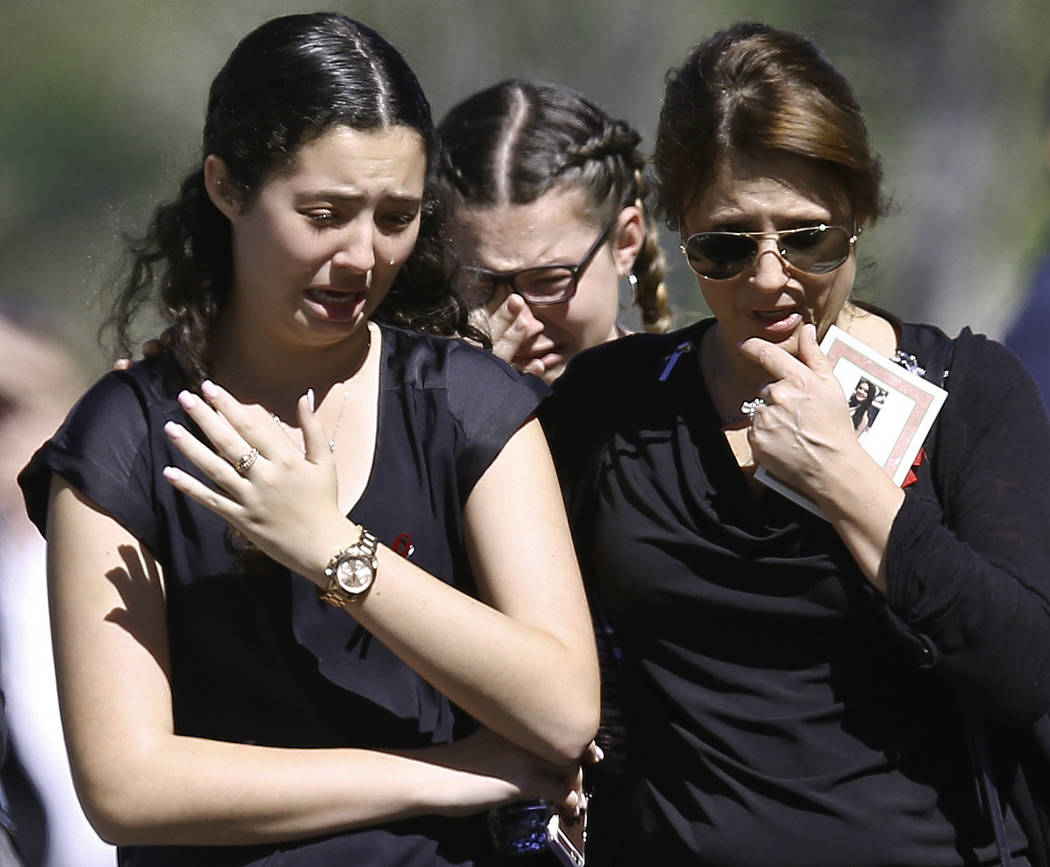 People weep as they leave a funeral service for Alyssa Alhadeff at the Star of David Funeral Chapel in North Lauderdale, Fla., Friday, Feb. 16, 2018. Nikolas Cruz, a former student, was charged wi ...