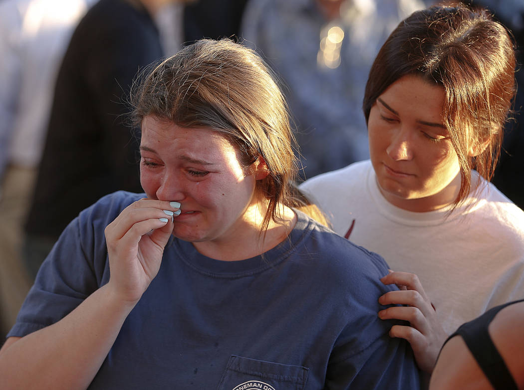 Students grieve during a vigil at Pine Trails Park for the victims of the Wednesday shooting at Marjory Stoneman Douglas High School, in Parkland, Fla., Thursday, Feb. 15, 2018. Nikolas Cruz, a fo ...