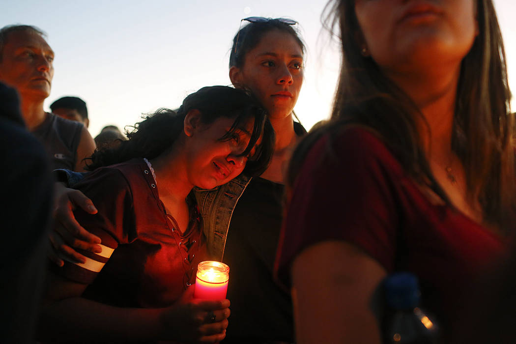 Students gather during a vigil at Pine Trails Park for the victims of the Wednesday shooting at Marjory Stoneman Douglas High School, in Parkland, Fla., Thursday, Feb. 15, 2018. Nikolas Cruz, accu ...