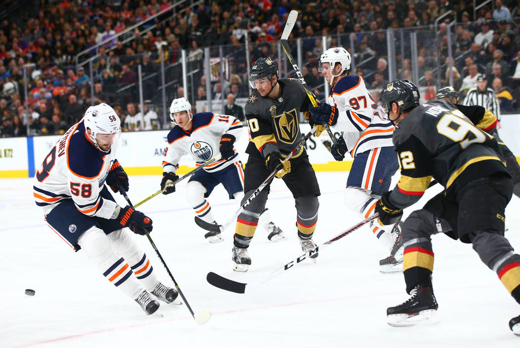 Golden Knights center Ryan Carpenter (40) watches the puck go past Edmonton Oilers left wing Anton Slepyshev (58) during an NHL game at T-Mobile Arena in Las Vegas on Thursday, Feb. 15, 2018. Chas ...